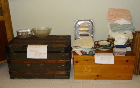 Antique steamer trunk - $75. Vintage toy chest - $20. Both 50% on the second day of the sale.